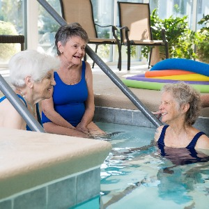 Women chatting by the pool at Heather Glen.
