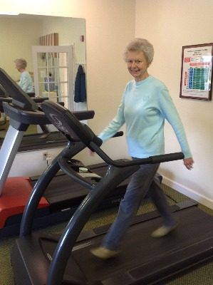 Woman on treadmill at Heather Glen.